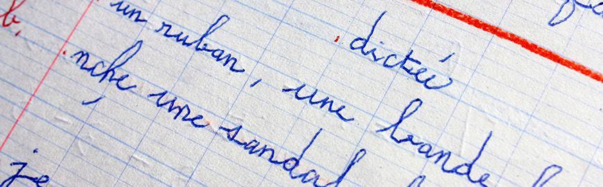 Cahier de dictée d'un élève.  Fotolia/Patryssia